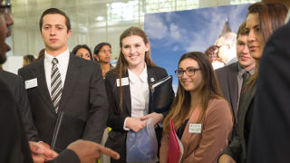 Students talking with an employer at a career fair