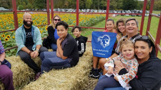 Alumni on a hayride at Tranquility Farms.