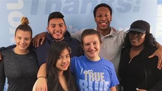 True Blue students standing together.