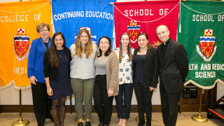 Some graduating members of the Servant Leader Scholars Program with Interim President Mary Meehan and Monsignor C. Anthony Ziccardi (from left to right): Angeli Fernandes, Christina Petruzzella, Adeline Laurente, Kathleen Lynch, Jacqueline Murdocca.