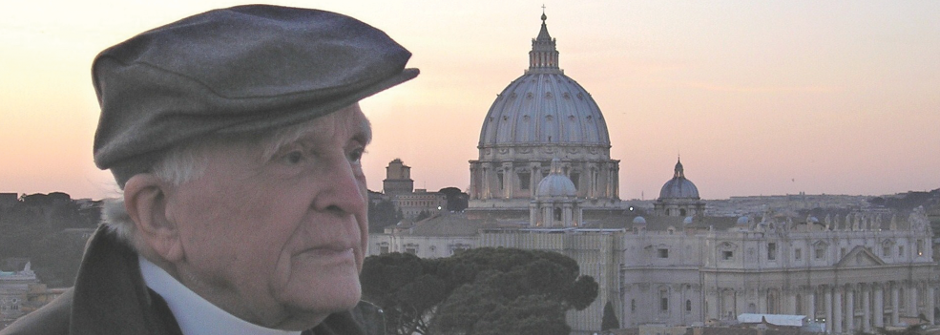 Fr. Jaki looking over a European city at sunset.