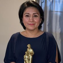 Picture of Kelly M Gutierrez holding award.