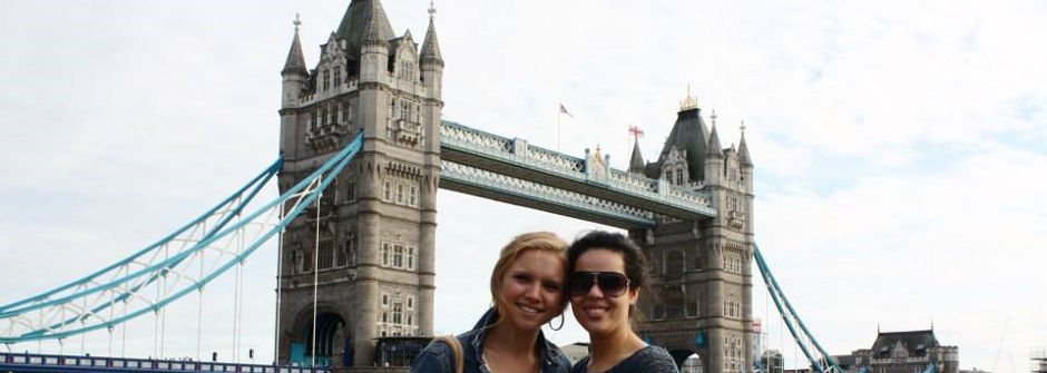 Two study abroad students in front of London Bridge.
