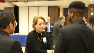 Mentor Linda Karten networking with students.