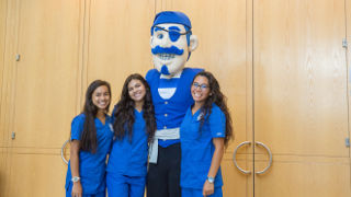 Nursing students with the Seton Hall pirate mascot.