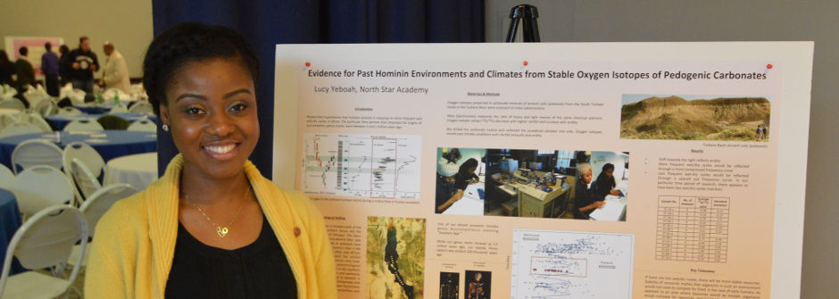 Student posing with her Petersheim poster presentation.