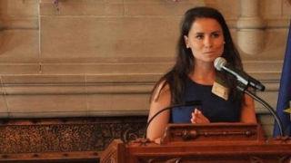Stephanie Fillion speaks on a podium