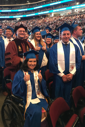 Student in a wheelchair at graduation ceremony.