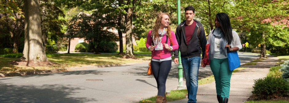 Students walking in a neighborhood off-campus.