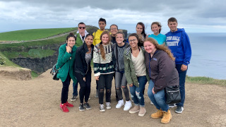 A group of Seton Hall students at the Cliffs of Moher in Ireland on a study abroad trip.