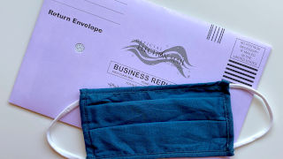 Mail-in ballot with a blue mask placed on top of it