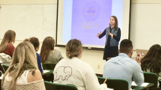 Professor lectures to a classroom of students