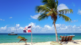Dominican Republic flag on a beach.