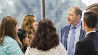 Dr. Kimble speaking with leadership students