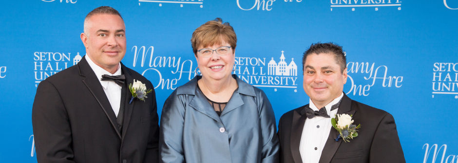 Dr. Christopher Fisher '93, Interim President Mary Meehan and Anthony Slimowicz '87 at the 2018 Many Are One Alumni Awards Gala.
