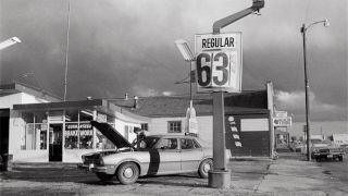 Black and white photo of old gas station