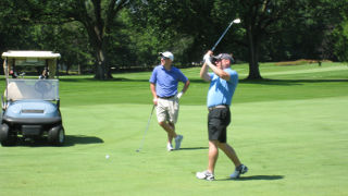 Photo of two men playing golf