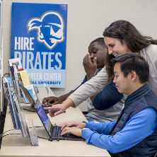Photo of Seton Hall students using a computer