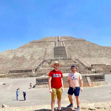 Two students standing in front of a pyramid