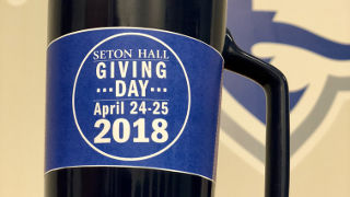 Photo of a mug with the Seton Hall Giving Day logo on it