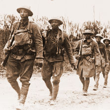 African American soldiers marching in war.