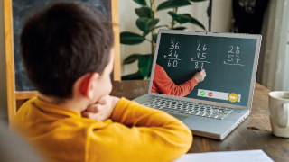 Child learning mathematics on a laptop.