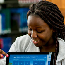 Female student looking at a computer