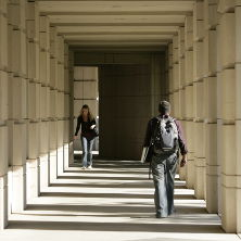 Students walking through the Walsh Library walkway.