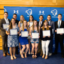 Student athletes with awards.