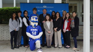 Interim President Mary J. Meehan, Former NJ Governor Richard J. Codey, members of CAPS, students and the Pirate mascot in front of the University Center.