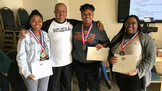 The 2017 recipients of the President's Volunteer Service Award Program: senior Kaliyah Inswood, junior Alexandra Recupero, sophomore Layla Ogletree and sophomore Marissa Louren Banks, taking a picture with Rev. Dr. Forrest Pritchett.