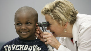Photo of a nurse with a child patient