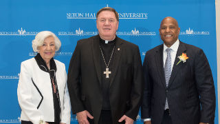 Honorees Marilyn Rosenbaum and Darrell K. Terry stand with Cardinal Joseph Tobin (middle) at the 2018 Evening of Roses.