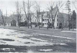 Left: 1927. The Saint Thomas Philosophy House, the former Darling family summer home, with the parish church on the left. - AAN