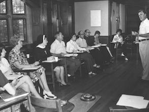 1970s. Reverend Leo Humanae conducting class for lay students and sisters. - Farley