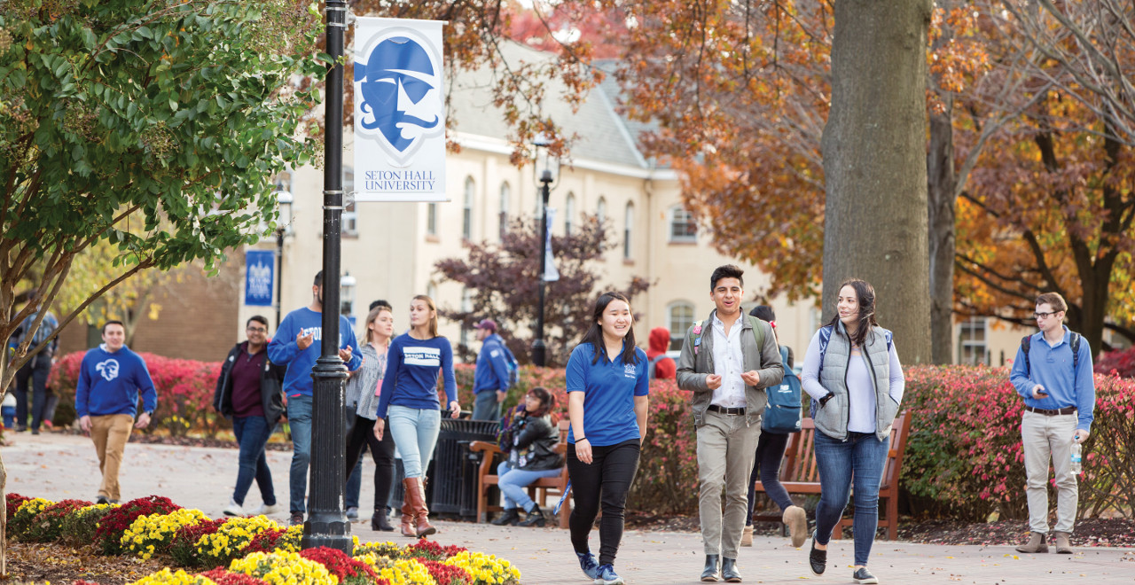 Students walking together on campus.