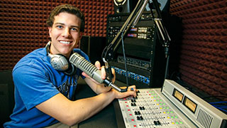 A Photo of a WSOU Student Working at the Radio Station