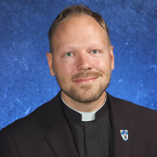 Headshot of Fr. Zack Swantek..